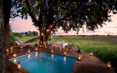 Private dining by the pool at Duba Plains. Photo courtesy of Great Plains Conservation.