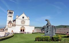 Basilica of San Francesco d'Assisi with statue of a horseback rider in the foreground