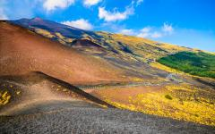 Where the barren and lush landscapes meet of Etna National Park in Sicily, Italy