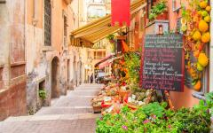 A walkway leading by a food market in Taormina, Italy