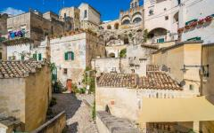 Cluster of stone buildings and streets in Sassi di Matera, Italy