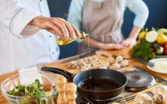 pouring oil in a pan during a cooking class