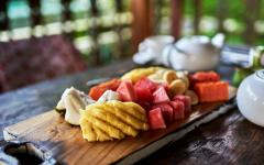 platter of tropical fruit on a table