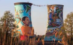 Murals on industrial towers in Soweto.