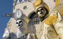 Man and woman dressed in masks and costumes for the Venice, Italy Carnivale