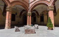 Group of stone slabs formed into benches in Bologna, Italy