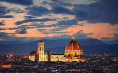 View of a well-lit Santa Maria del Fiore Cathedral at dawn | Florence, Italy
