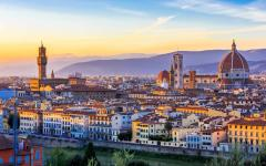 View of Florence at sunset with the Santa Maria Cathedral and the Palazzo Vecchio peering over all other buildings
