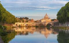 St. Peter's Basilica in the background with its reflection in the Tiber River in the foreground