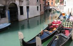 Pair of traditional gondolas parked on a Venice canal