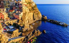 Beautiful view of Manarla Village at sunset on the Cinque Terre coastline in Northern Italy