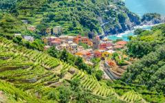 View looking down upon the town of Monterosso al Mare, Italy with its very lush, green surroundings