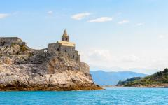 Church of St. Peter standing high on a rocky point above the seawater in Porto Venere, Italy