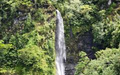 waterfall coming down a mountain in the jungle