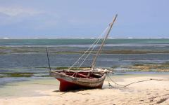 Mombasa tour boat parked on a Kenya beach