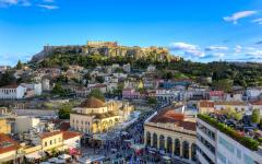 The town of Plaka, Greece with Acropolis Hill standing high in the background
