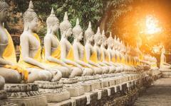 A row of Buddha statues at the Buddhist temple of Wat Yai Chai Mongkhon in Ayutthaya.