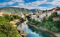 The Neretva River runs under Stari Most - Old Bridge - in Mostar, Bosnia and Herzegovina.