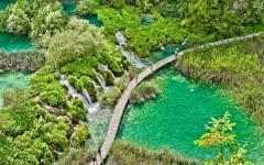 An aerial shot of a wooden walkway located in Plitvice Lakes National Park.