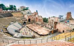 View from the bleachers in the amphitheater, Teatro Antico di Taormina in Sicily, Italy