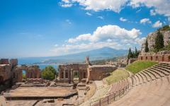 Greek theater in Taormina, Italy with Mount Etna in the background
