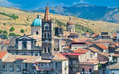 View of clocktower and buildings in town of Randazzo, Italy
