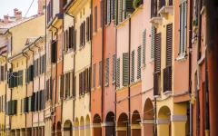 Beige and yellow apartment buildings in Bologna, Italy