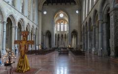 Interior view of the Basilica di San Lorenzo Maggiore with statue of Jesus Christ in the foreground