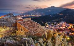 View of the hilltop town Taormina, Italy at dusk