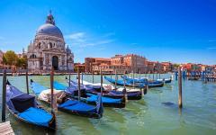Parked gondolas in front of Santa Maria della Salute in Venice, Italy.