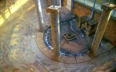 Pillars in the Villa Romana del Casale with mosaic art on the floor and walls