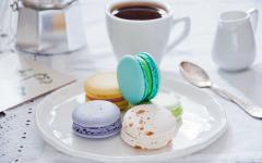 Breakfast with colorful macaroons.