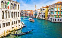 View boats and gondoliers on the Grand Canal in Venice, Italy