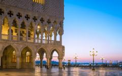 Doge's Palace with a pink and blue sky at dusk in Venice, Italy