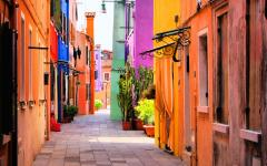 Street leading through colorful buildings on Burano Island, Venice, Italy