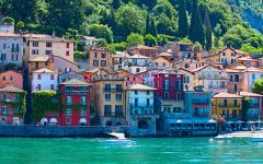 Colorful houses on a hillside bordering Lake Como in Lombardy, Italy