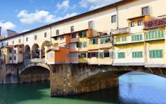 The Bridge Ponte Vecchio hanging over Arno River