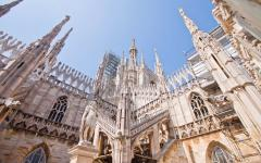 Closeup, upward view of the intricate architecture of the Piazza Duomo in Milan, Italy