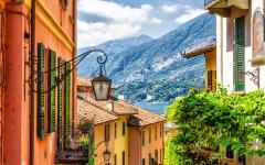 View peering through Bellagio, Italy buildings with Lake Como in the background