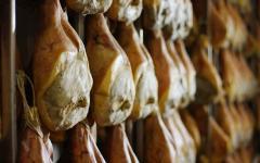 Parma ham curing in a cellar.