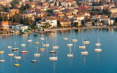 Group of parked sailboats on Lake Garda in Sirmione, Italy