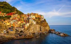 Seaside village on a cliff-overhang in Cinque Terre, Italy