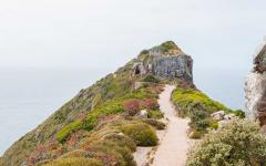 Hiking trail leading to an old stone structure | Capetown, Africa