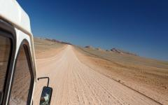 View from a safari tour jeep window of the Namib Desert, Namibia, Africa