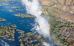 Aerial view of Victoria Falls with mist cloud forming at the bottom of the falls | Zambia, Africa