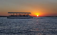 A tour boat on the Chobe River during sunset | Botswana, Africa
