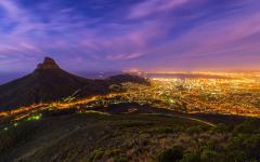 Outside view of the Capetown, South Africa nightlife with Lion's Head Mountain standing tall over all the lights