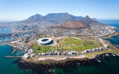Aerial view of Capetown, South Africa with the Capetown Stadium, Lion's Head and Table Mountain in view