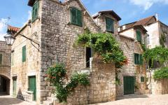A stone building with shutters on Hvar island, Croatia.