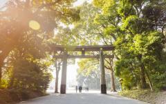 Japan Tour - People Walking Under Tokyo's Gate